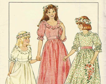 Sewing pattern Style 3673 Fitted bodice round neck frill short puffed sleeves gathered skirt to waist hem edge Size 4 & 6 vintage uncut