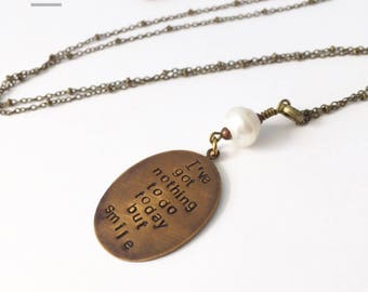 I've got nothing to do today but smile necklace in brass with freshwater pearl detail