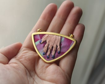 Crafter's hand with blue nail polish // Hand embroidered pendant