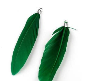 A set of 2 pendants feathers green 70 mm and silver metal.