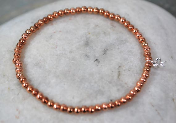 Rose Gold Plumeria Bead Bracelet