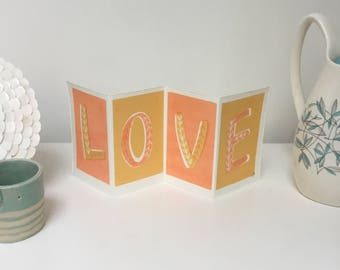 Love - pink gold. Screenprinted love token. 20% of each sale to charity.