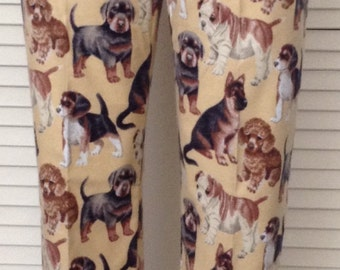 Puppy dogs on tan background flannel pajama pants