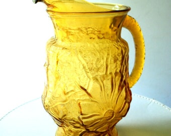 Boho vintage 70s amber art glass , hand blowing , heavy, large pitcher  with a flowers pattern.