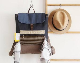 Unisex, dark navy canvas backpack / Laptop bag / diaper bag / Front zipper pocket. 7 inside pockets. Waterproof lining available