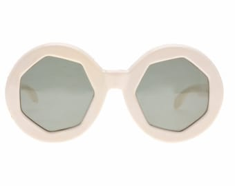 Unusual 1960s round oversized sunglasses by Baruffaldi, collectable frames with polygonal cut rims and green lenses, vintage NOS 1960s