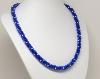 Kumihimo necklace in blue and silver colour