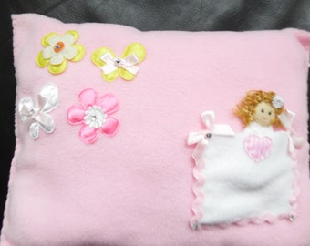 Pillow, doll and bag