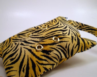Wristlet in Tiger Print with Gold Grommets