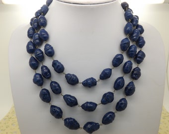 A beautiful chunky retro period 1950s / 60s triple row vintage jewelry necklace made with shiny nobbly blue glass beads strung on chain