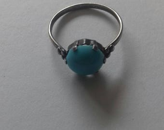 Vintage ring with light blue stone.
