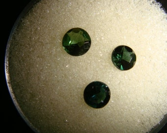 3 Green tourmaline faceted  4 mm rounds    .73 carats