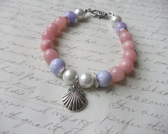 Pink and lavender jade bracelet with pearls and silver shell charm