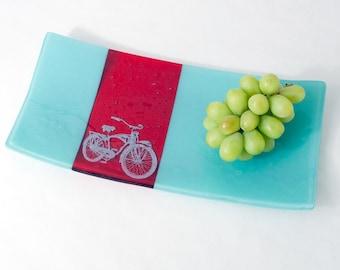 Bicicleta de vitrofusión una fuente de servir