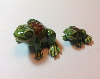 Two ceramic frogs