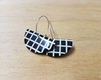 Handmade polymer clay earrings in black and white grid pattern on surgical steel hoops