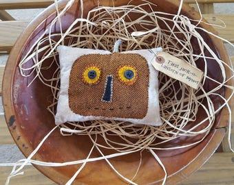 That jack-o-lantern of mine - primitive wool applique jack-o-lantern on an osnaburg pillow tuck