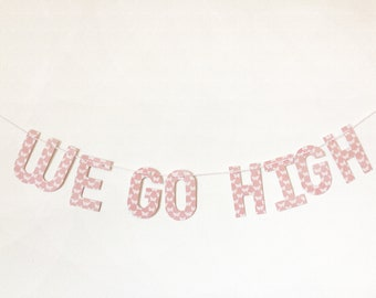 We Go High banner on butterfly patterned paper