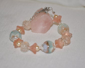 LAMPWORK BEADED BRACELET  Pink and Blue Highlights in the Boro Beads Sterling Silver Accents and Heart Shaped Toggle Closure
