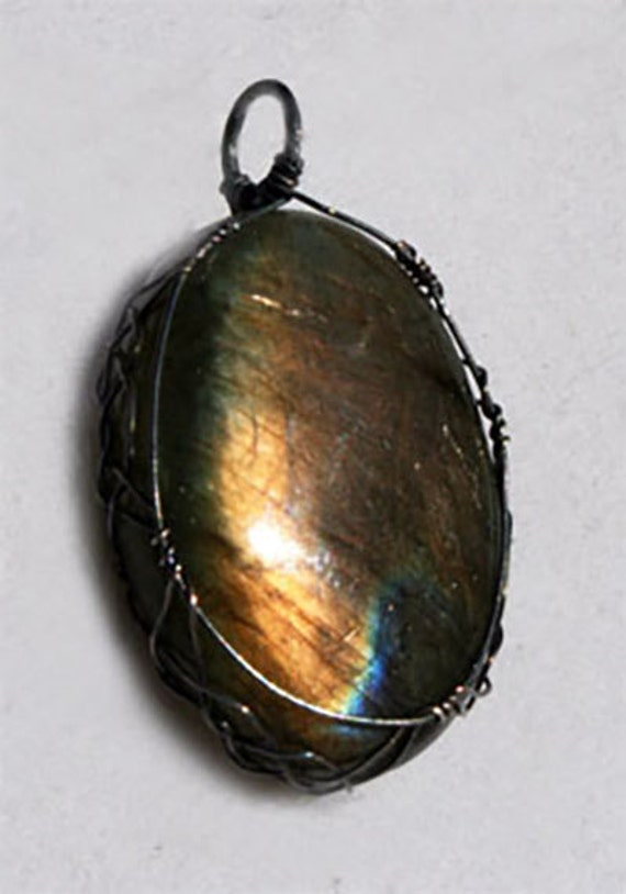 Labradorite pendant wrapped Celtic style in oxidized sterling silver
