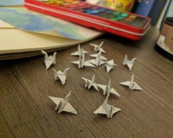 10 tiny line paper cranes