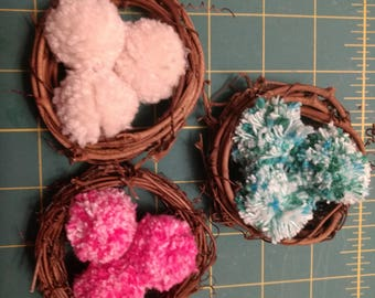 "Set of 3 Mini Nests with Pompom ""Eggs""."