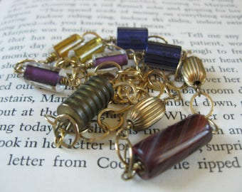 Purple and gold glass lampwork and brass bead and gold chain necklace