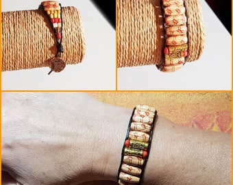 Leather wrap bracelet and wooden beads.