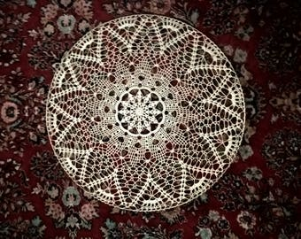 Doily on metal ring