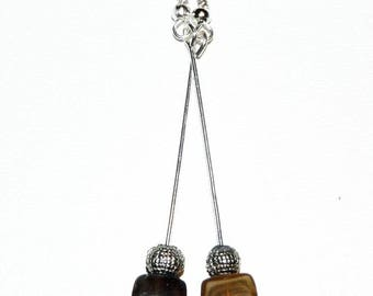 Brown cubes and dangling earrings