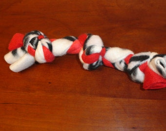 Braided fleece dog toy, with 3 knots, 8 to 12 in. long for the  small dog / puppy.