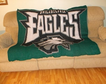 "A  knitted afghan of the Philadelphia Eagles. The Eagle afghan measures 53""w x 55""l. Stephanie acrylic yarns used to knit my Eagle afghan."