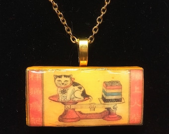 Chinese cat on scale - Domino pendant necklace - classic vintage matchbox label