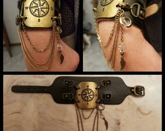 Black leather compass cuff with chain accents