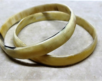 A Pair of Old Hand Carved Horn Bracelets from Africa