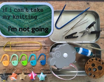Knitting notions for travel: removable stitch markers - thread scissors - tape measure - needle gauge