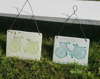 Wall hanging clay tile with hand painted bicycle detail