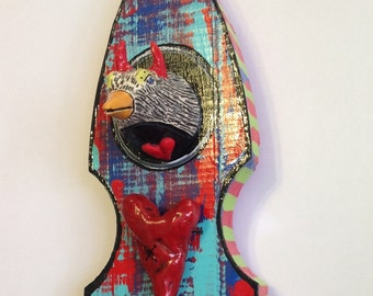 Ceramic Horned Bird Head on Wood