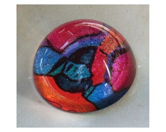 Ornamental Paperweight with bright colors from Star Shadow print in red green blue orange