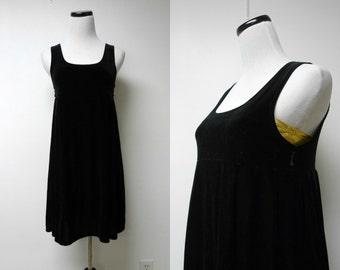 "black velvet . sleeveless . empire . babydoll pleated dress . size 16 . bust 31.5"" . made in USA"