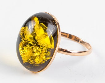 Gold ring with natural green amber