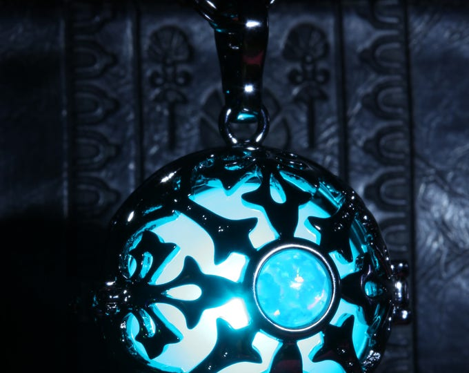 Glowing necklace pendant, locket with teal glowing LED orb and turquoise opal stone