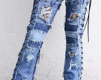 Dark Blue denim on a pair of vintage light Blue jeans with snake skin