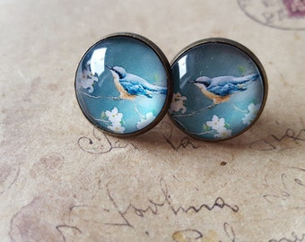 Birds and glass cabochon earrings in green