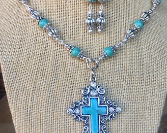 Handmade turquoise and silver cross pendant beaded necklace and earring set