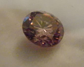 loose pinkish purple moissanite .79 ct brilliant cut  round 6.0mm