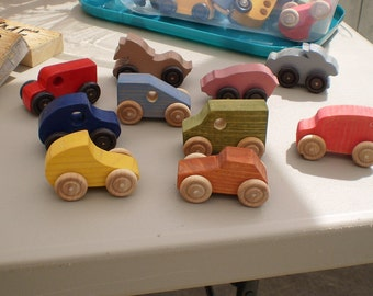 asst small toy wood cars and some animals on wheels