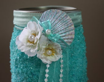 wedding centerpiece beach themed wedding frozen blue these are very textured  with real sea shells and flowers .