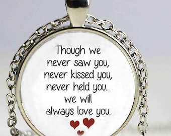 A beautiful necklace with a glass cabochon 25 mm love text