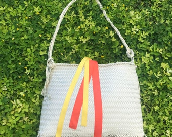 Handwoven shoulder bag with yellow and orange ribbons